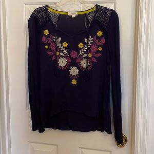 Navy top with floral design